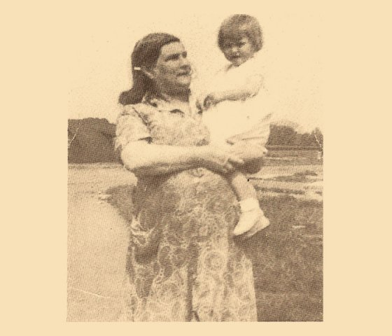Maggie Jane Sweeney with baby Maureen Doherty in her arms. 1957