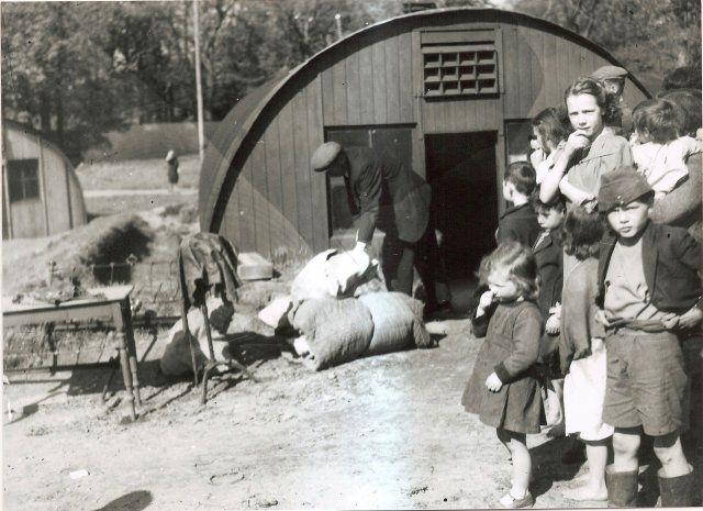 Bailiff at work in Belmont Camp as the children look on in bewilderment 12 may 1947