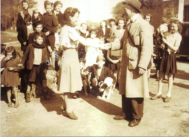 Delivery man saying goodbye to Mrs Mc Guiness at Belmont Camp on the day she was evicted Monday 12 May 1947